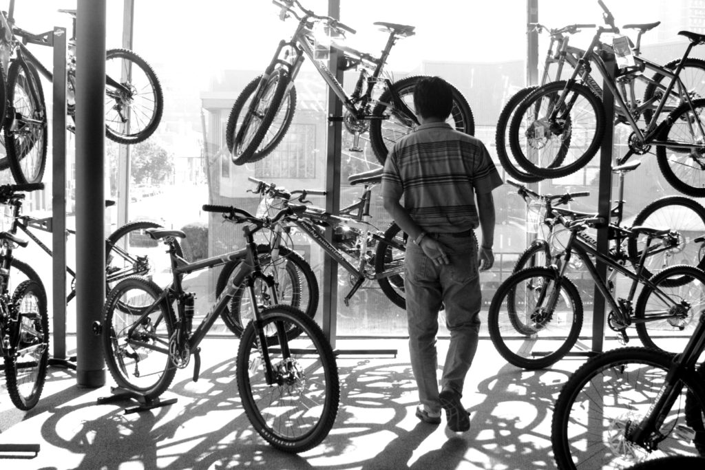 Man inspects bicycles on display