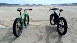 Two fat tire bikes on a sand dune