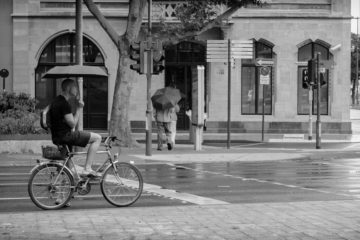 Man cycling in the rain.