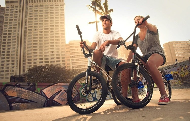 Man And Female Sitting On BMX