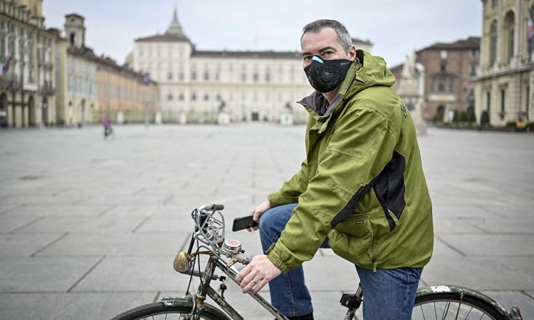 Man With Mask On Bike
