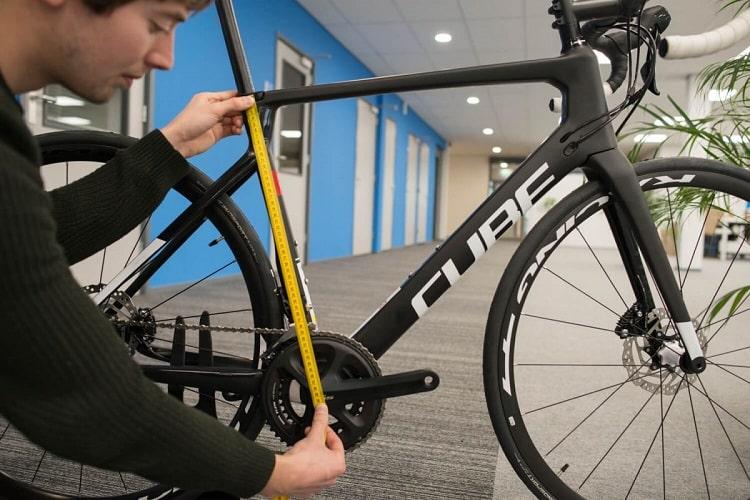 Man Measuring Bike Frame