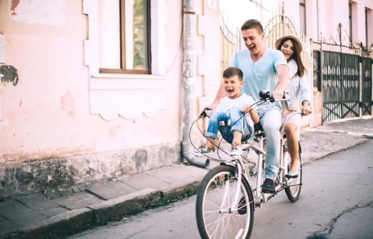 family with kid on tandem bike