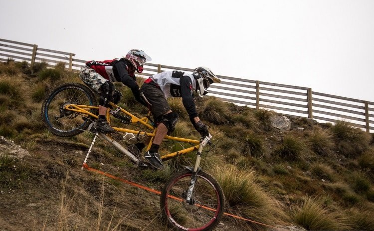 downhill race with tandem bike